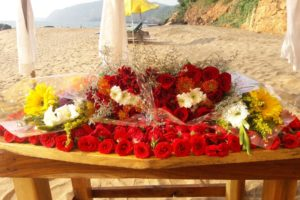 Flowers for an engagement celebration on the beach.